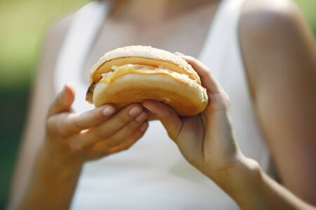 Cute and stylish girl with a humburger