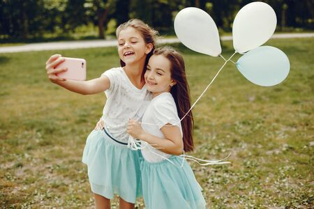 cute girls with ballons Stockfoto