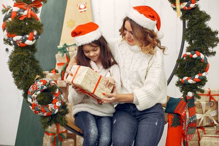 Mother with cute daughter in a christmas decorations Foto de archivo