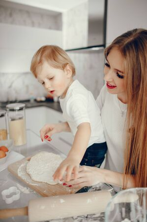 Mother and son cook the dough for cookies