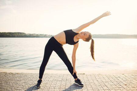 Sports girl. Woman in a summer park. Lady in a sports wear