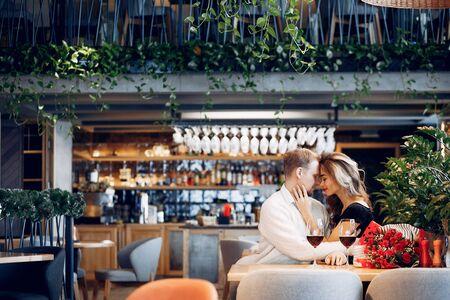 Elegant couple spend time in a restaurant Standard-Bild - 139454149