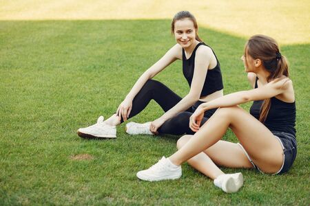 Sports girls training at the stadium Standard-Bild - 139456836