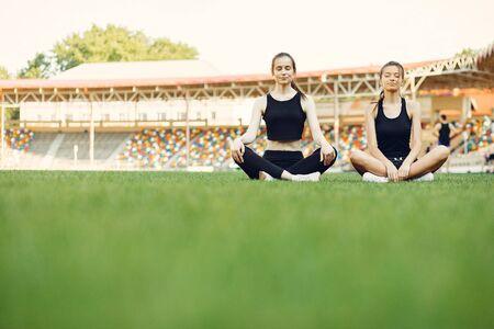 Sports girls training at the stadium Standard-Bild - 139457406