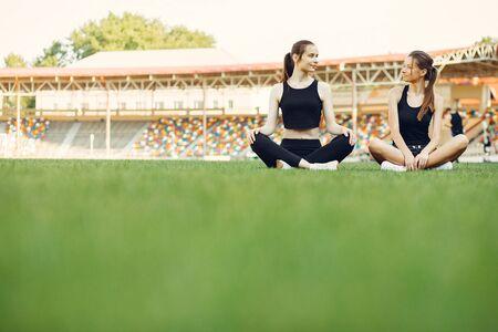 Sports girls training at the stadium Standard-Bild - 139457416
