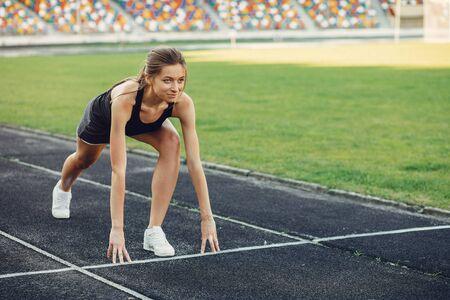 Sports girl training at the stadium Standard-Bild - 139460772