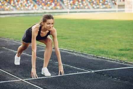 Sports girl training at the stadium Standard-Bild - 139460846