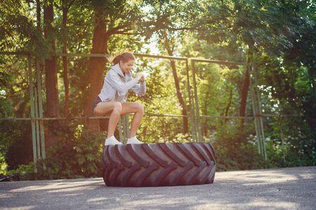 Sports girl training ain a summer park Standard-Bild - 139460819