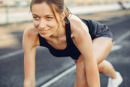 Sports girl training at the stadium Standard-Bild - 139570635