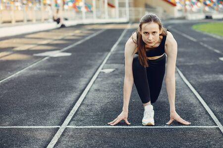 Sports girl training at the stadium Standard-Bild - 139570621