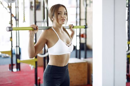 Sports girl training in a morning gym