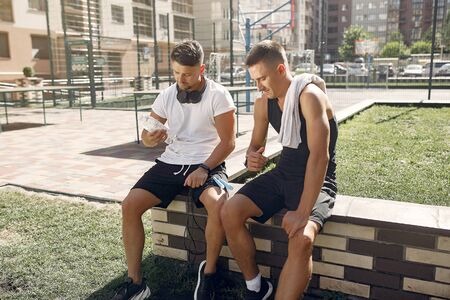 Men in a sports clothes have a rest after training