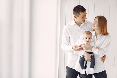 Beautiful family standing on a white background Standard-Bild