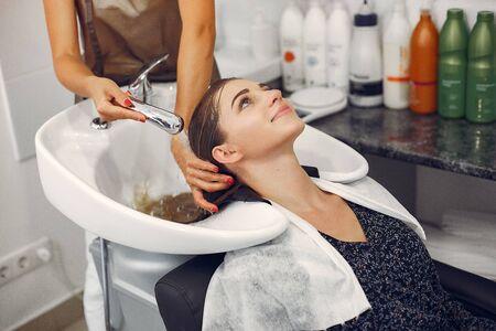 Woman washing head in a hairsalon Stock Photo