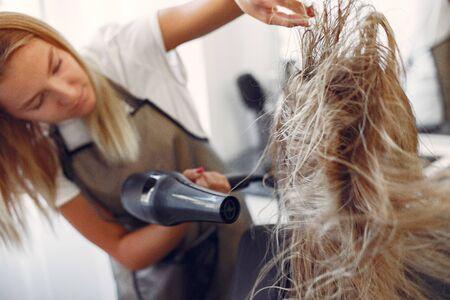 Woman drying hair in a hairsalon