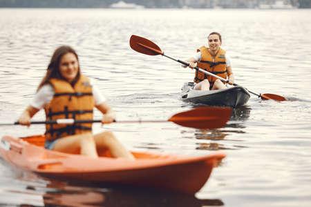 Women paddling on a lake in a kayak