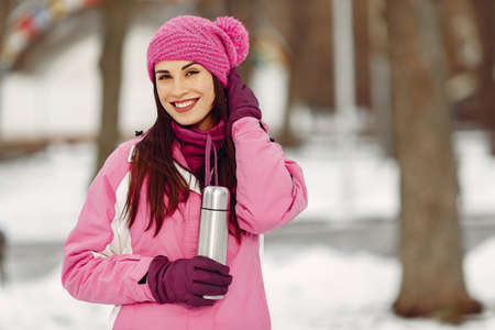 Woman in winter sports clothes looking at camera