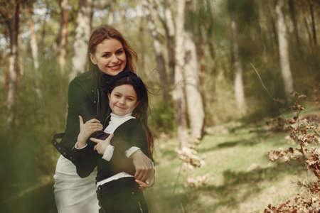 Elegant mother with daughter in a summer forest Standard-Bild