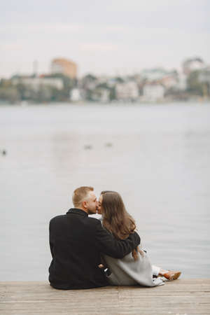 Beautiful couple spend time by the water Standard-Bild - 158268235