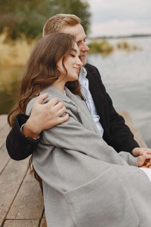 Beautiful couple spend time by the water Standard-Bild - 158270507