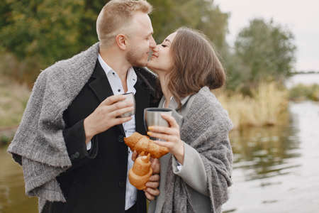 The beautiful couple spend time together with coffee and croissant Standard-Bild - 158270812
