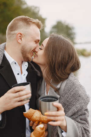 The beautiful couple spend time together with coffee and croissant Standard-Bild - 158270815
