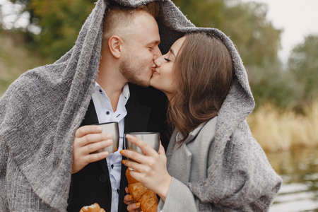 The beautiful couple spend time together with coffee and croissant