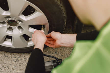 Man changing wheel after a car breakdown. Transportation, traveling concept.
