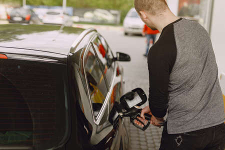 Man on a gas station. Guy refuelong a car. Standard-Bild - 158271218