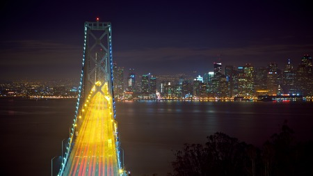 san francisco bay bridge: San Francisco Bay Bridge and Cityscape at Night