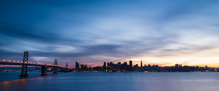 urban travel: San Francisco skyline at sunset with dramatic clouds
