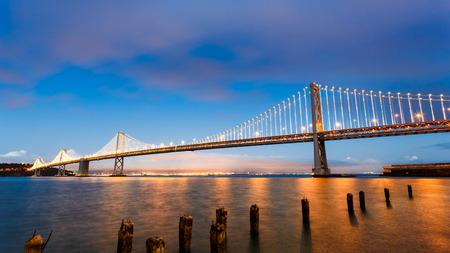 San Francisco-Oakland Bay Bridge illuminated at sunset