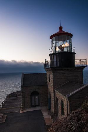 sur: Point Sur lighthouse in Big Sur, California at sunset