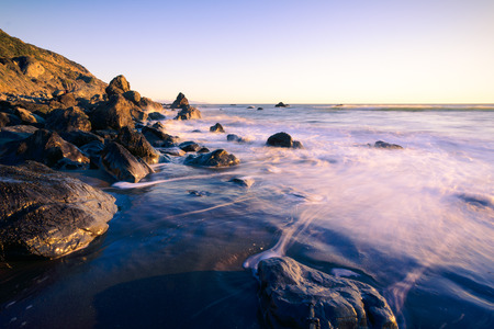 the ocean state: Ocean waves and rocks at Muir Beach, California