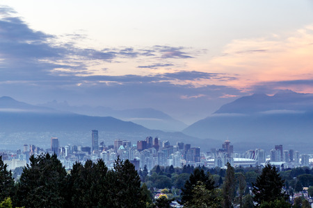 Vancouver skyline at dusk as seen from Queen Elizabeth Park British Columbia Canada
