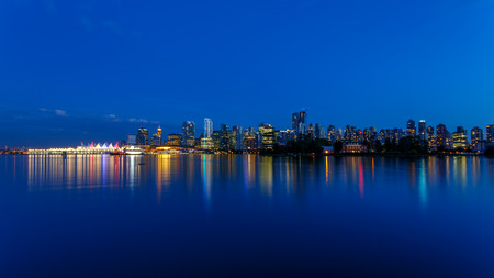 vancouver island: Vancouver skyline at Dusk as seen from Stanley Park British Columbia Canada
