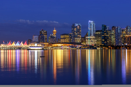 sundown: Vancouver skyline at Dusk as seen from Stanley Park British Columbia Canada
