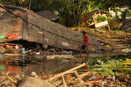 Tsunami victims collects items from a damaged house in Carita district, Banten province, Indonesia on December 28, 2018