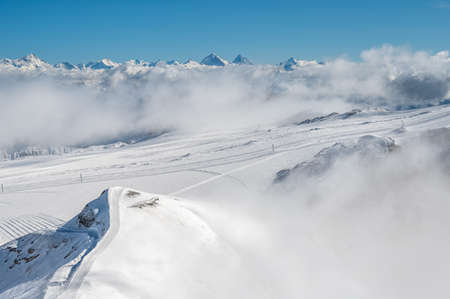Winter landscape of snowcapped mountains with blue sky on sunny day. Famous Diablerets Glacier in Switzerland. Tranuility and beauty in nature. Stok Fotoğraf