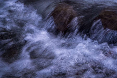 Water flowing over rocks. Long exposure. Abstract background. Beauty in nature. Stock fotó