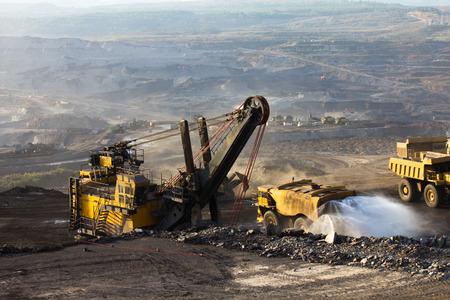 mining truck: Mining truck working Stock Photo