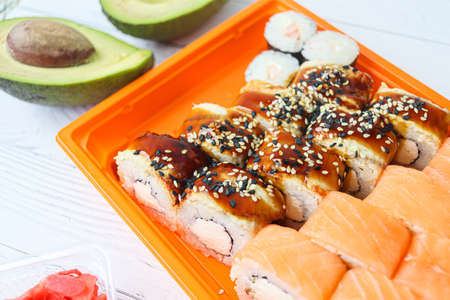 Roll made of Fresh Raw Salmon, Smoked Eel, Cream Cheese and Avocado inside. Topped with Smoked Eel or unagi