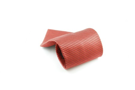 red tie: Red tie coiled on white background Stock Photo