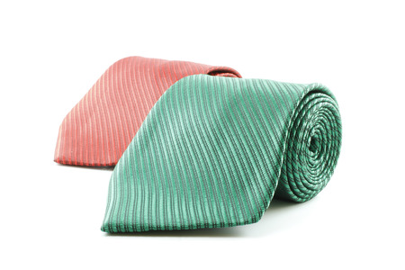 elastic garments: two rolled up neckties isolated on white Stock Photo