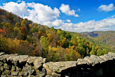 Beautiful autumn view from top of mountain of the peak of the fall leaf change over. photo