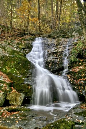Small waterfall viewed in mid autumn along hiking trail.