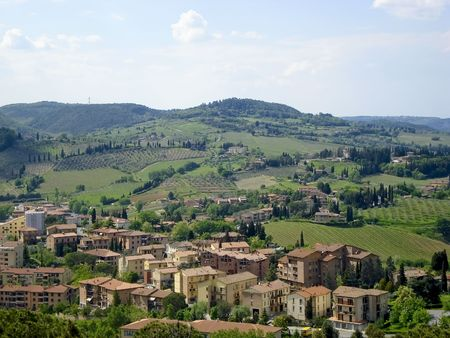 county side: High view of Tuscany county side.  Viewing down into a valley at homes and vallies.