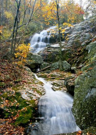 Tall and beautiful waterfall in the middle of autumn. Stock Photo - 3076442