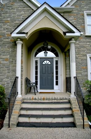 Enterance door to new modern stone house.