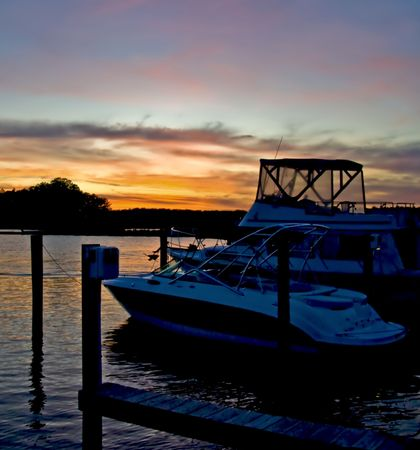 Beautiful sunset at a pier with docked boats. photo